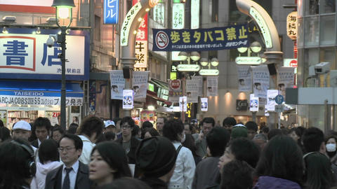 A crowd of people cross an intersection in the Shibuya... Stock Video Footage