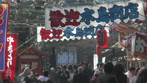 Banners, lanterns and pedestrians in Ueno Park during the... Stock Video Footage