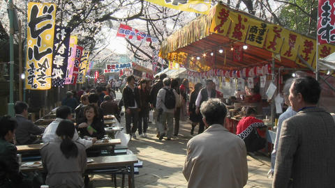 Food stalls and pedestrians in Ueno Park during the... Stock Video Footage