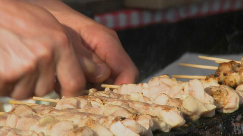 A street vendor prepares yakitori in a Ueno Park food... Stock Video Footage