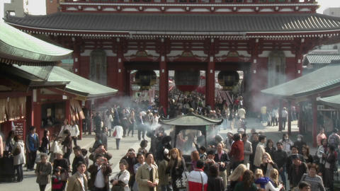 Visitors burn incense at the Senso-ji or Asakusa... Stock Video Footage