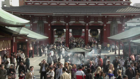Visitors burn incense at the Senso-ji or Asakusa Kannon-do Temple, located in Tokyo, Japan Footage