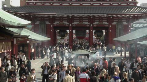 Visitors burn incense at the Senso-ji or Asakusa Kannon-do Temple, located in Tokyo, Japan Footage