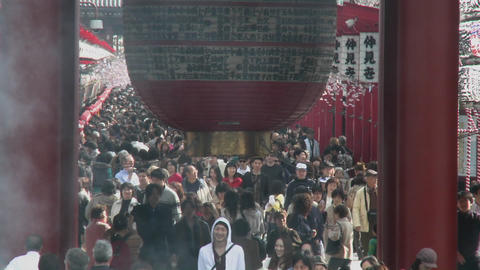 Visitors enter the famous gate of the Senso-ji or Asakusa... Stock Video Footage