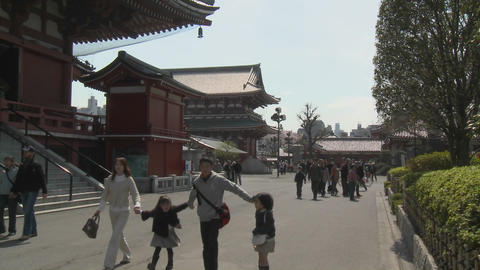A young family shares a warm spring day at the Senso-ji Temple complex in Asakusa, Tokyo, Japan Footage