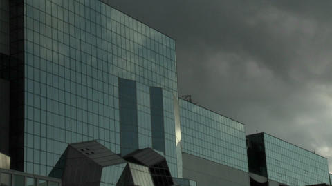 Time lapse of clouds reflected in the glass facade of the... Stock Video Footage