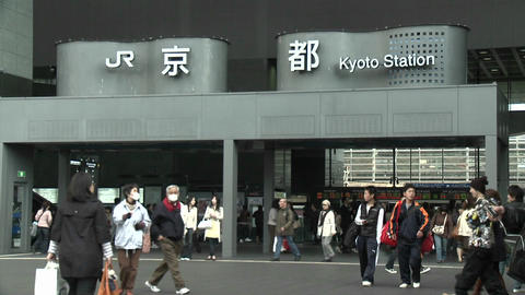Commuters at the entrance to the JR Station, Kyoto, Japan Live Action