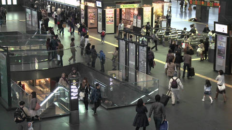 Commuters and turnstiles at the JR Station, Kyoto, Japan Footage