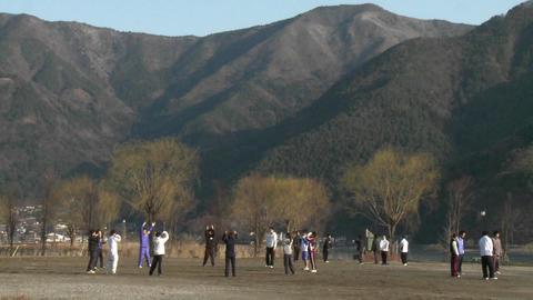 Morning exercises on the shore of Lake Kawaguchi-ko, a... Stock Video Footage