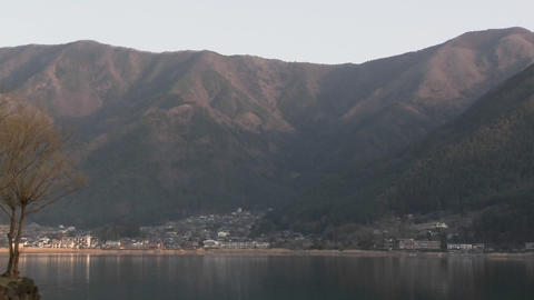 Pan across Lake Kawaguchi, a popular tourist destination at the base of Mt. Fuji, Japan Footage