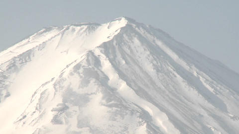 Pull back from Mt. Fuji across Lake Kawaguchi, a popular... Stock Video Footage