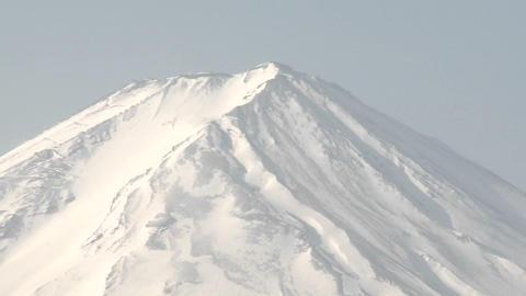 Pull back from Mt. Fuji across Lake Kawaguchi, a popular... Stock Video Footage