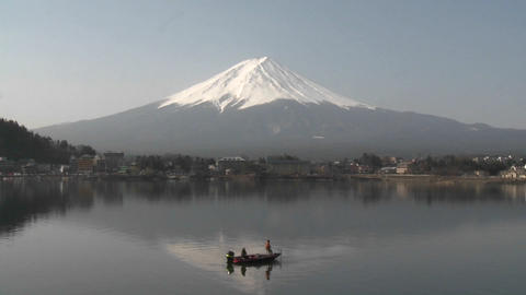Mt. Fuji and fishermen reflected in Lake Kawaguchi, Japan Stock Video Footage