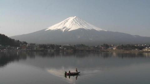 Mt. Fuji and fishermen reflected in Lake Kawaguchi, Japan Stock Video Footage