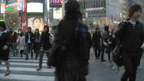 Pedestrians crossing the intersection in front of Shibuya Station, Tokyo, Japan Footage