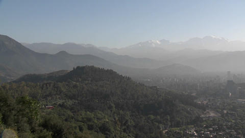 Pan across the smog filled city of Santiago to the Andes... Stock Video Footage