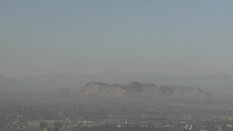 Vertical pan of smog filled city of Santiago, Chile Stock Video Footage