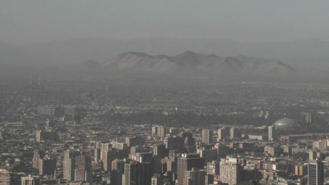 Vertical pan of smog filled city of Santiago, Chile Live Action