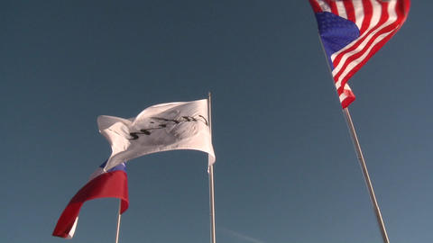 The flags of the United States and Chile flying at Vina Calina, a winery located in Talca, Chile Footage