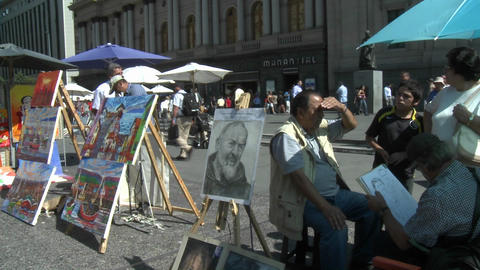A street artist paints a portrait in the Plaza de Armas,... Stock Video Footage