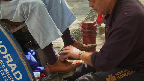 A shoe shine on Paseo Ahumada, a pedestrian street in... Stock Video Footage