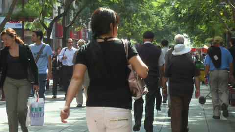 Foot traffic on Paseo Ahumada, a pedestrian street in downtown Santiago, Chile Footage