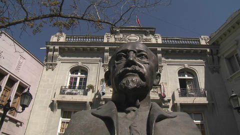 Pan across a statue in a small square in the Londres area of Santiago, Chile Footage