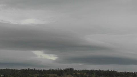 Dark rain clouds race across the sky near Talca, Chile Stock Video Footage