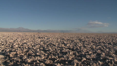 Vertical pan over the mineral formations at the Laguna Chaxa at the Salar de Atacama in the Reserva Footage