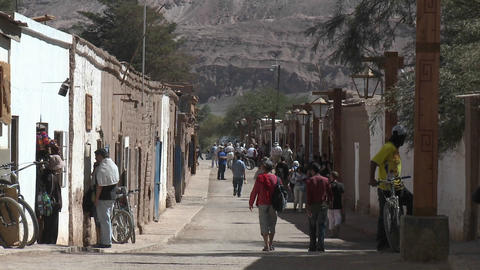 Slow move in on pedestrians in San Pedro de Atacama, Chile Stock Video Footage