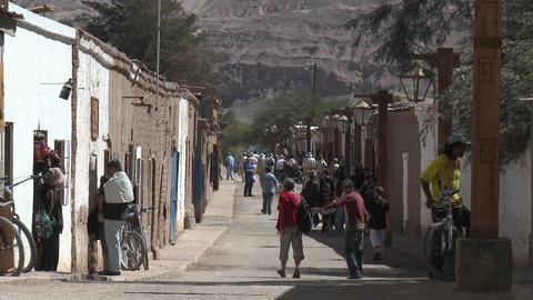 Slow move in on pedestrians in San Pedro de Atacama, Chile Stock Video Footage