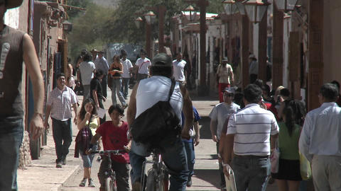Slow move out on pedestrians in San Pedro de Atacama, Chile Stock Video Footage