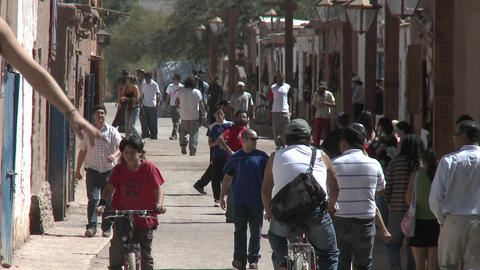 Slow move out on pedestrians in San Pedro de Atacama, Chile Footage