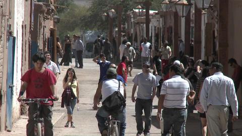 Slow move out on pedestrians in San Pedro de Atacama, Chile Stock Video Footage
