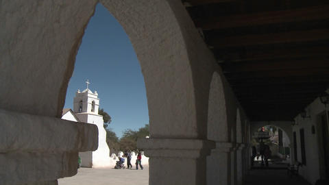 Vertical pan of the Iglesia San Pedro framed in the arches of the Casa Incaica, San Pedro de Atacama Footage