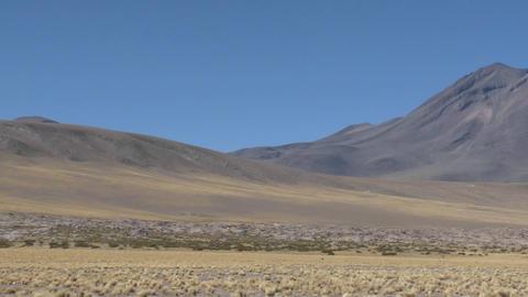 Pan across a barren volcanic peak near San Pedro de... Stock Video Footage