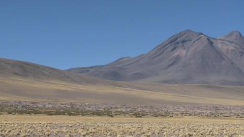Pan across a barren volcanic peak near San Pedro de Atacama, Chile Footage