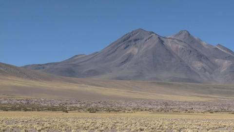 Pan across a barren volcanic peak near San Pedro de... Stock Video Footage