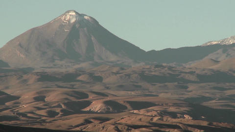A snow capped volcano in the Andes high above San Pedro de Atacama, Chile Footage