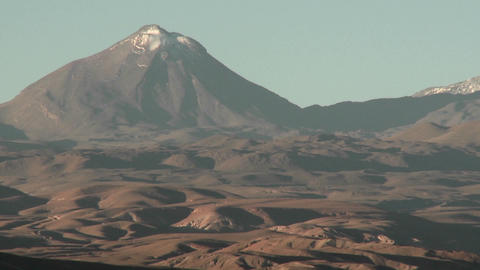 A snow capped volcano in the Andes high above San Pedro... Stock Video Footage