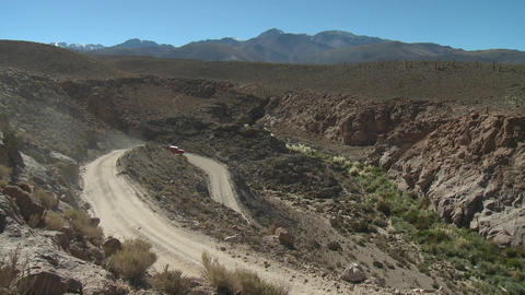 A truck on a winding dirt road in the altiplano above San... Stock Video Footage