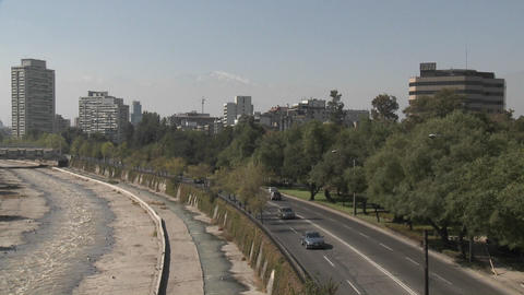 Pan across automobile traffic along the Rio Mapocho in... Stock Video Footage
