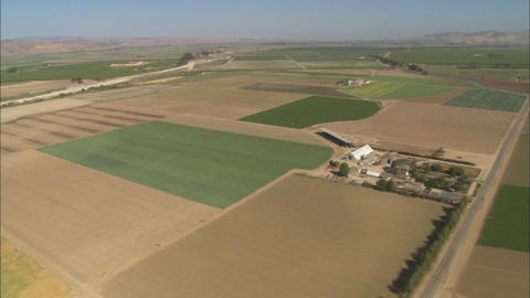 Helicopter aerial of farmland in the Salinas Valley, California Footage