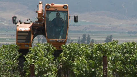 Time lapse of mechanized tilling in a Monterey County... Stock Video Footage