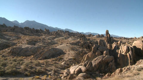 Pan across the granite rock formations of the Alabama Hills and the Sierra Nevada Range above Lone P Footage