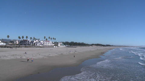 A runner on the sand at Pismo Beach, California Stock Video Footage