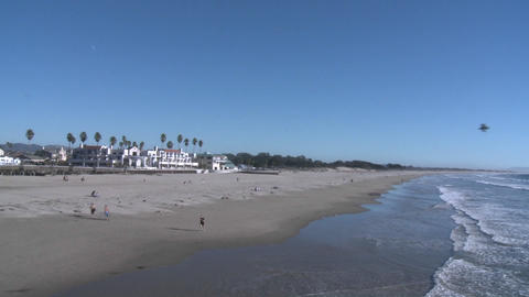 A runner on the sand at Pismo Beach, California Footage