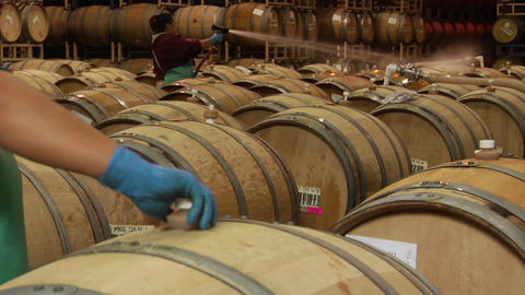 A woman hoses off wine barrels in a Santa Barbara County... Stock Video Footage