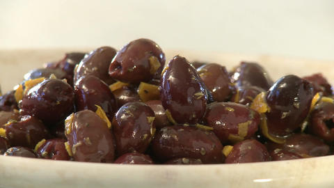 Horizontal pan of olives and cheese in a plate Stock Video Footage