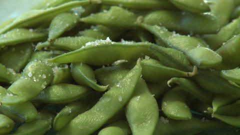 Close up pan of salted organic soy bean pods Stock Video Footage